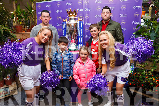 Ella Scanlon and Katie Walsh with David Flaherty, Davey J Flaherty, Ian Flaherty, Conor Cronin and Katelyn O'Brien pictured with the Premier League Cup in SuperValu Tralee on Wednesday afternoon.