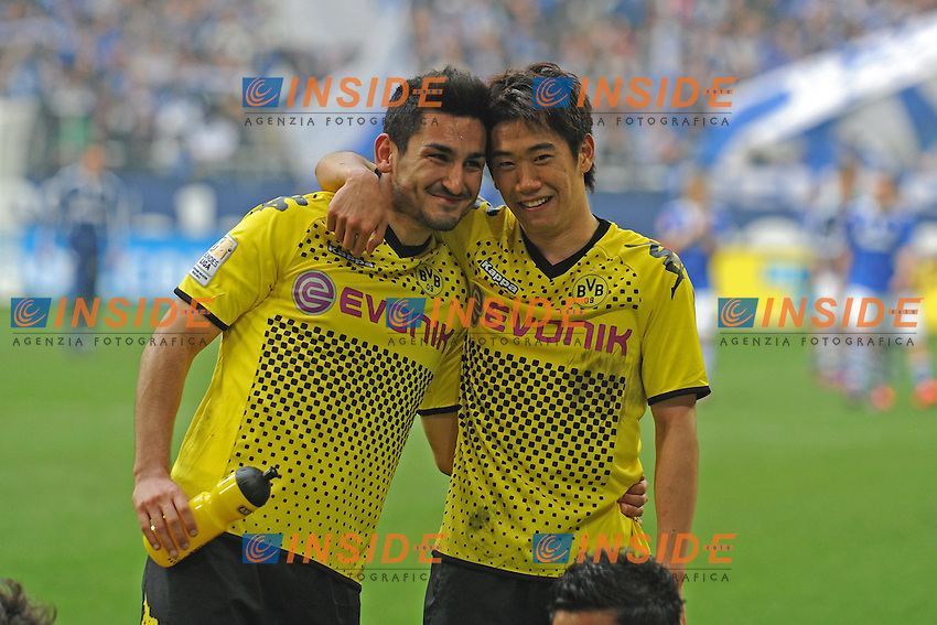 14.04.2012, Veltins Arena, Gelsenkirchen, GER, Schalke 04 vs Borussia Dortmund, 31. Spieltag, im Bild V.l.n.r. Ilkay Guendogan und Shinji Kagawa ( beide Borussia Dortmund/ Portrait ) freuen sich riesig ueber den Auswaertssieg sowie die fast sichere deutsche Meisterschaft // during the German Bundesliga Match, 31th Round between Schalke 04 and Borussia Dortmund at the Veltins Arena, Gelsenkirchen, Germany on 2012/04/14. EXPA Pictures © 2012, PhotoCredit: EXPA/ Eibner/ Alexander Neis.. .Italy Only