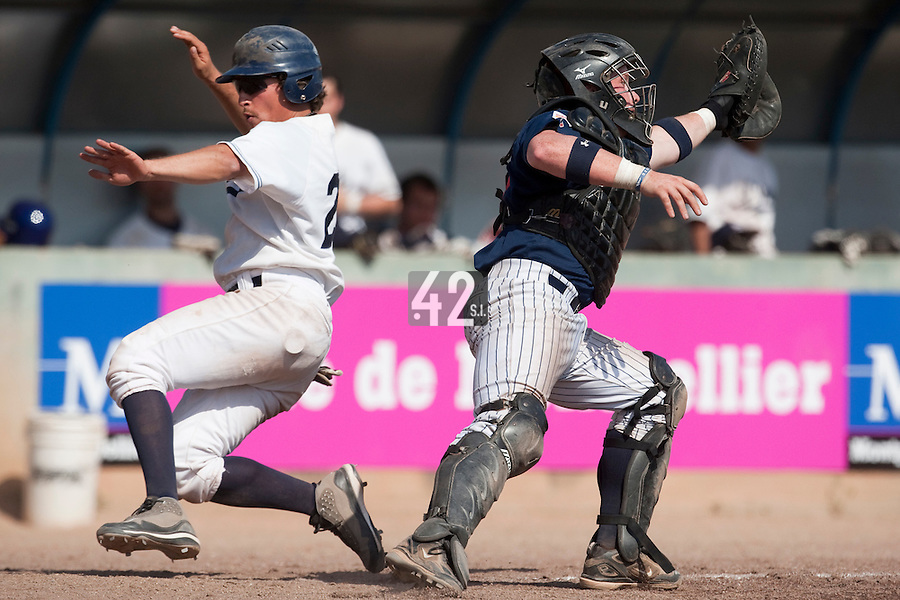 24 May 2009: Romain Scott-Martinez of Savigny slides safely into home plate as David Gauthier catches the ball during the 2009 challenge de France, a tournament with the best French baseball teams - all eight elite league clubs - to determine a spot in the European Cup next year, at Montpellier, France. Rouen wins 7-5 over Savigny.