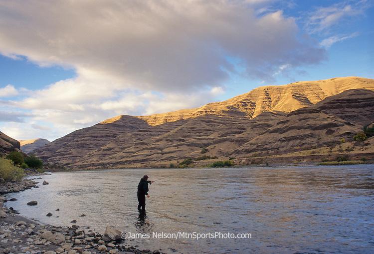 08010-W. An angler casts a fly for steelhead on the Snake River near Lewiston, Idaho.