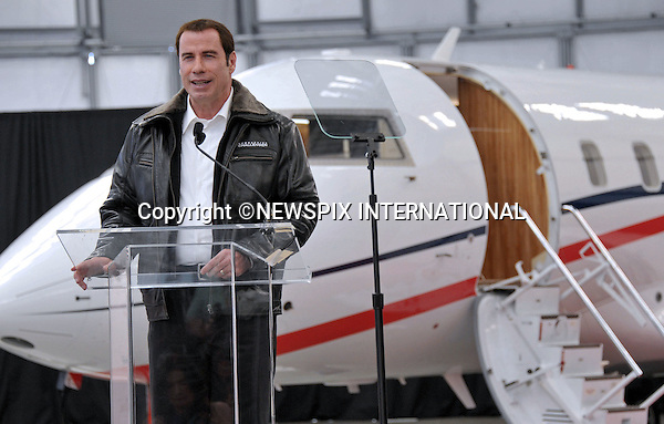 "JOHN TRAVOLTA.has signed up to promote Bombardier's Learjet, Challenger and Global business jets as a ""brand ambassador""_Burbank, California_20 September 2011..The world's largest business aircraft manufacturer says the actor and producer recently added a pre-owned Challenger 601 aircraft to the 11 different jets he's qualified to fly..The Oscar-nominated actor also owns a Learjet 24 and previously owned a small Canadair De Havilland plane..Travolta,57, also promotes Australia's Qantas Airlines and Breitling watches..Mandatory Photo Credit: ©Crosby/Newspix International..**ALL FEES PAYABLE TO: ""NEWSPIX INTERNATIONAL""**..PHOTO CREDIT MANDATORY!!: NEWSPIX INTERNATIONAL(Failure to credit will incur a surcharge of 100% of reproduction fees)..IMMEDIATE CONFIRMATION OF USAGE REQUIRED:.Newspix International, 31 Chinnery Hill, Bishop's Stortford, ENGLAND CM23 3PS.Tel:+441279 324672  ; Fax: +441279656877.Mobile:  0777568 1153.e-mail: info@newspixinternational.co.uk"