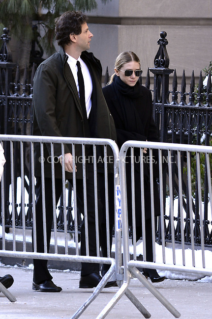 WWW.ACEPIXS.COM<br /> <br /> February 7 2014, New York City<br /> <br /> Ashley Olsen attending Philip Seymour Hoffman's funeral at St Ignatius Loyola Church in Manhattan on February 7, 2014 in New York City. <br /> <br /> By Line: Curtis Means/ACE Pictures<br /> <br /> <br /> ACE Pictures, Inc.<br /> tel: 646 769 0430<br /> Email: info@acepixs.com<br /> www.acepixs.com