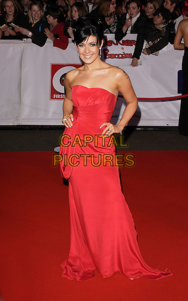 KYM MARSH .The National Television Awards, Royal Albert Hall, London, England..October 31st, 2007.TV full length dress hands on hips strapless red ryder.CAP/ROS.©Steve Ross/Capital Pictures