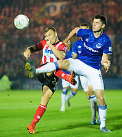 Lincoln City's Harry Anderson battles with Everton's Michael Keane<br /> <br /> Photographer Andrew Vaughan/CameraSport<br /> <br /> The Carabao Cup Second Round - Lincoln City v Everton - Wednesday 28th August 2019 - Sincil Bank - Lincoln<br />  <br /> World Copyright © 2019 CameraSport. All rights reserved. 43 Linden Ave. Countesthorpe. Leicester. England. LE8 5PG - Tel: +44 (0) 116 277 4147 - admin@camerasport.com - www.camerasport.com