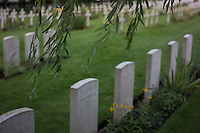 Gravestones of Chinese labourers died during World War I stand at Lijssenthoek Military Cemetery in Poperinge, West Flanders, Belgium, August 27, 2014. 2014 marks 100th anniversary of the Great War.