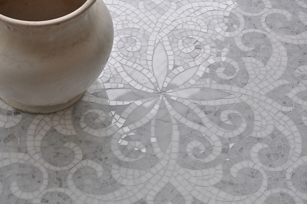 Arabella, a handmade mosaic shown in polished hand-cut and waterjet-cut Carrara and Thassos, is part of the Silk Road Collection by Sara Baldwin for New Ravenna.<br />