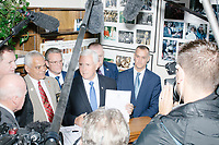 Vice President Mike Pence stands in front of the media in the New Hampshire Secretary of State's office in the New Hampshire State House  in Concord, New Hampshire, on Thu., November 7, 2019. Pence traveled to New Hampshire as a surrogate for Donald Trump to file required paperwork for the president to get on the New Hampshire presidential primary ballot in 2020. The required documents include a filing form signed by the candidate and a $1000 filing fee.During the filing, Pence was surrounded by prominent New Hampshire and New England Republicans including former Trump campaign manager Corey Lewandowski.