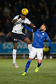 29th January 2019, Palmerston Park, Dumfries, Scotland; Scottish Cup football, 4th round replay, Queen of the South versus Dundee; Genserix Kusunga of Dundee heads away from Stephen Dobbie of Queen of the South