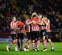 Lincoln City's Matt Rhead, centre, celebrates scoring the opening goal with team-mates<br /> <br /> Photographer Chris Vaughan/CameraSport<br /> <br /> The EFL Checkatrade Trophy Group H - Lincoln City v Mansfield Town - Tuesday September 4th 2018 - Sincil Bank - Lincoln<br />  <br /> World Copyright © 2018 CameraSport. All rights reserved. 43 Linden Ave. Countesthorpe. Leicester. England. LE8 5PG - Tel: +44 (0) 116 277 4147 - admin@camerasport.com - www.camerasport.com
