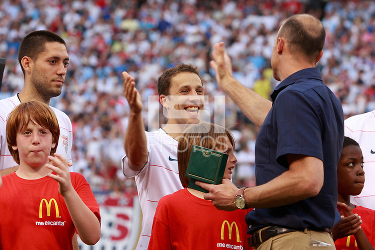 USA goalkeeper Kasey Keller shakes hands with defender Steve Cherundolo (6) after being honored for his 100th appearance. The men's national teams of the United States and Argentina played to a 0-0 tie during an international friendly at Giants Stadium in East Rutherford, NJ, on June 8, 2008.