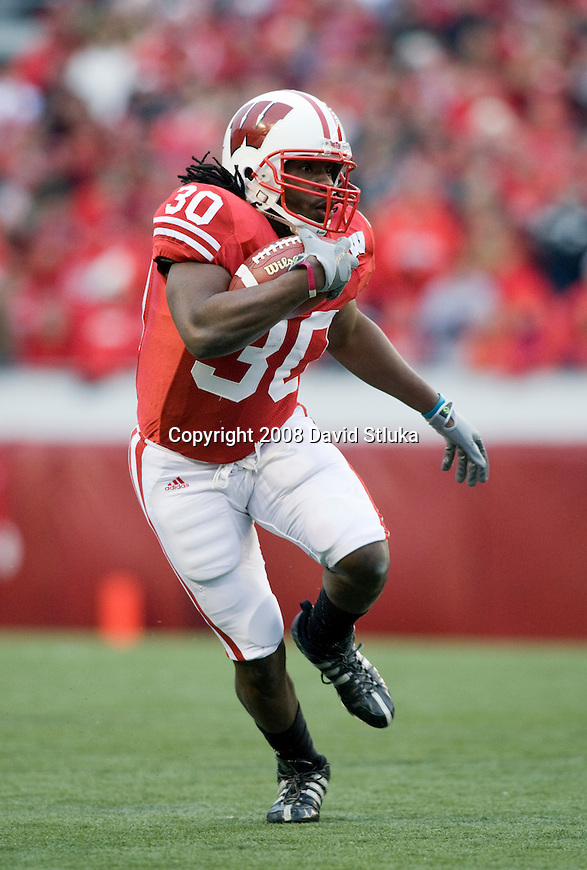 MADISON, WI - NOVEMBER 22: Running back Zach Brown #30 of the Wisconsin Badgers carries the ball against the Cal Poly Mustangs at Camp Randall Stadium on November 22, 2008 in Madison, Wisconsin. Wisconsin beat Cal Poly 36-35 in overtime. (Photo by David Stluka)