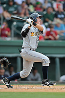 Catcher Radley Haddad (20) of the Charleston RiverDogs bats in a game against the Greenville Drive on Sunday, August 16, 2015, at Fluor Field at the West End in Greenville, South Carolina. Charleston won, 6-2. (Tom Priddy/Four Seam Images)