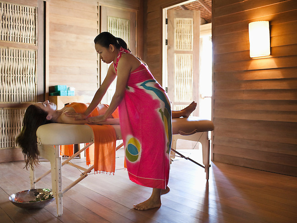 A woman receives a Lomi-Lomi Massage, a traditional Hawaiian Massage that combines dance movements, breathing, rhythmic music and an oil massage in an 80-minute treatment. The Spa at Six Senses Hideaway Yao Noi, Koh Yao Noi, Thailand.