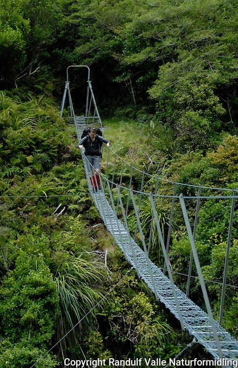 Jente krysser hengebru ---- Girl crossing swing bridge