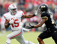 Ohio State Buckeyes running back Ezekiel Elliott (15) stiff arms Purdue Boilermakers cornerback Ricardo Allen (21) during the first half of the NCAA football game at Ross-Ade Stadium in West Lafayette, Ind. on Nov. 2, 2013. (Adam Cairns / The Columbus Dispatch)