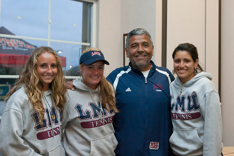 April 20, 2011; San Diego, CA, USA; Loyola Marymount Lions womens tennis head coach Jamie Sanchez (second from right) poses for a photo with seniors Estelle LaPorte (far left), Shauna Morgan (second from left), and Melissa Valenzuela (far right) during the WCC Tennis Championships at the Barnes Tennis Center.