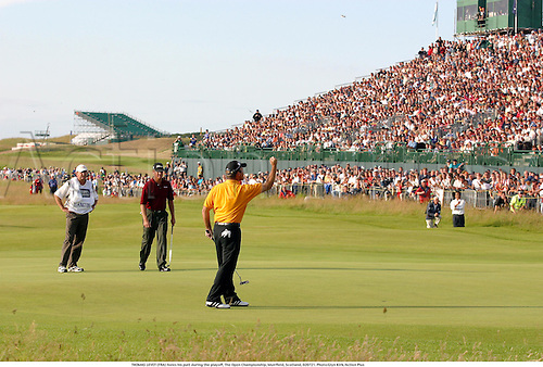 THOMAS LEVET (FRA) holes his putt during the playoff, The Open Championship, Muirfield, Scotland, 020721. Photo:Glyn Kirk/Action Plus...Golf.2002.putting putts.green greens.sequence