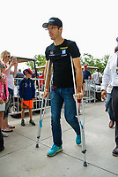 May 28, 2017; Indianapolis, IN, USA; Injured IndyCar Series driver Sebastian Bourdais walks with crutches prior to the 101st Running of the Indianapolis 500 at Indianapolis Motor Speedway. Mandatory Credit: Mark J. Rebilas-USA TODAY Sports