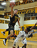 Dom Pryor #22 of Ward Melville tries to make an acrobatic move but gets whistled for a charge during a non-league varsity boys basketball game against host St. Anthony's High School on Thursday, Dec. 15, 2016. St. Anthony's won by a score of 52-48.