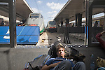 Rome; Italy; Europe; Roma Termini, Stazione Centrale; Rome train station, train departures, sleeping teenage man,.
