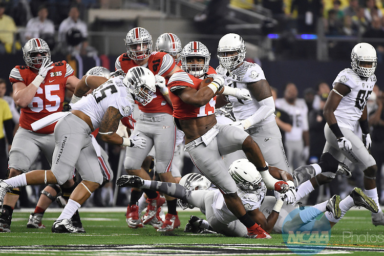 12 JAN 2015:  Ezekiel Elliott (15) of the Ohio State University rushes for a touchdown against the University of Oregon during the College Football Playoff National Championship held at AT&T Stadium in Arlington, TX.  Ohio State defeated Oregon 42-20 for the national title.  Jamie Schwaberow/NCAA Photos