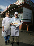 Rose and Nick Lonardo, holding a sausage sandwich, in front of Carbone's Sausage Market and Deli on October 24, 2008. (ELLEN JASKOL/ROCKY MOUNTAIN NEWS)