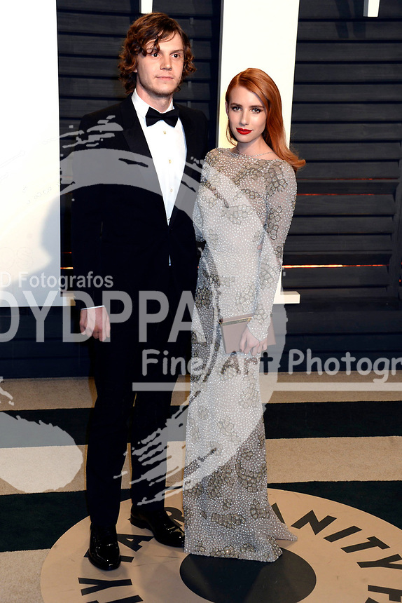 Evan Peters and Emma Roberts attend the 2017 Vanity Fair Oscar Party hosted by Graydon Carter at Wallis Annenberg Center for the Performing Arts on February 26, 2017 in Beverly Hills, California.