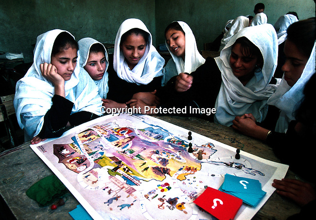 Girls in a school in Kabul, Afghanistan. The women are not allowed to study or work by the ruling Taliban regime. The women are forced to wear a traditional Burka, that covers them from top to toe..©Per-Anders Pettersson/iAfrika Photos