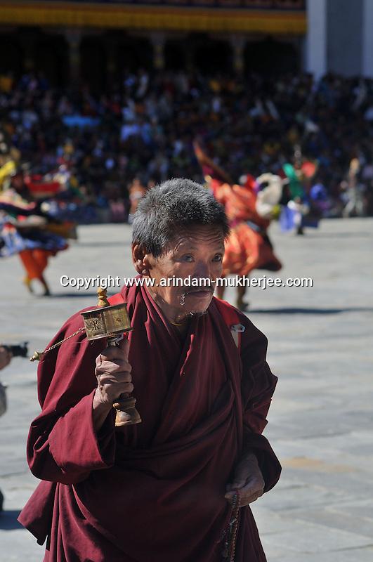 A bhutanese man with a prayer wheel in his hand entering Thimpu Dzong for Annual Tsechu festival. Arindam Mukherjee