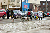 Rookie Tamara Rose runs behind her sled on Front street as she nears the finish line in Nome during the 2010 Iditarod