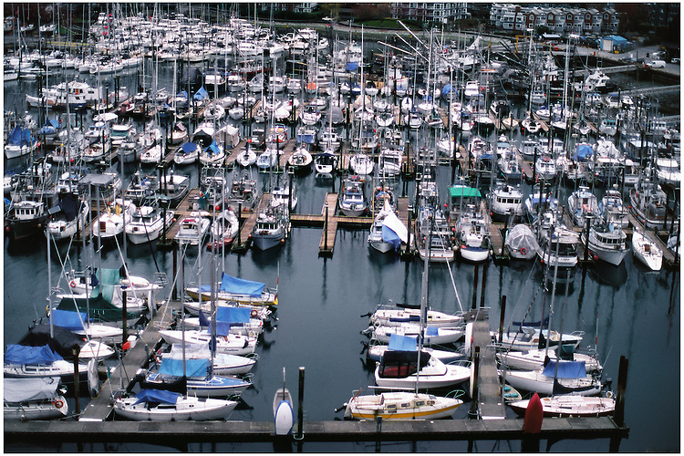 Two empty parking spots for boats in marina on False Creek South, taken from the Burrard Bridge in winter, Vancouver, BC.