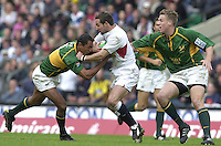 25/05/2002 (Saturday).Sport -Rugby Union - London Sevens.England vs South Africa.Ben Gollings, is held by Paul Treu(L) and Jean DeVilliers[Mandatory Credit, Peter Spurier/ Intersport Images].