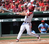 NWA Democrat-Gazette/ANDY SHUPE<br /> Arkansas first baseman Trevor Ezell connects Saturday, June 8, 2019, for a double during the first inning against Ole Miss in the NCAA Super Regional game at Baum-Walker Stadium in Fayetteville. Visit nwadg.com/photos to see more photographs from the game.
