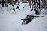 People dig out their cars in the Huron Village neighborhood in Cambridge, Massachusetts, USA, on Saturday, Feb. 9, 2013, after Winter Storm Nemo hit the area.