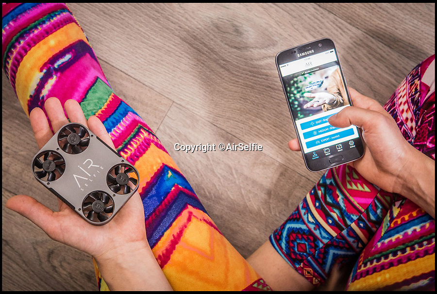BNPS.co.uk (01202 558833)<br /> Pic: AirSelfie/BNPS<br /> <br /> The AirSelfie fits in the palm of your hand is controlled via a smartphone.<br /> <br /> An amazing new hands free gadget allows selfie-obsessed millennials to get the perfect shot of themselves.<br /> <br /> The AirSelfie is a tiny flying camera that hovers above the taker's head so they can capture memorable moments like never before.<br /> <br /> The pocket-sized flyer is controlled by an app that can be downloaded on most smartphones and can stay in the air for up to five minutes at a time.