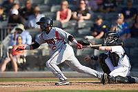 Devin Hairston (6) of the Carolina Mudcats follows through on his swing against the Fayetteville Woodpeckers at SEGRA Stadium on May 18, 2019 in Fayetteville, North Carolina. The Mudcats defeated the Woodpeckers 6-4. (Brian Westerholt/Four Seam Images)