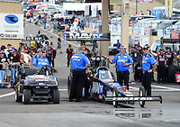 Jul, 20, 2012; Morrison, CO, USA: NHRA crew members for top fuel dragster driver Brandon Bernstein during qualifying for the Mile High Nationals at Bandimere Speedway. Mandatory Credit: Mark J. Rebilas-