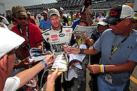 Jul. 4, 2008; Daytona Beach, FL, USA; NASCAR Sprint Cup Series driver Dale Earnhardt Jr signs autographs during qualifying for the Coke Zero 400 at Daytona International Speedway. Mandatory Credit: Mark J. Rebilas-