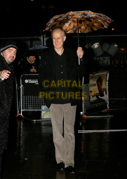 "JAMES CROMWELL.London Film Festival UK Premiere of ""The Constant Gardener"", opening night gala, London, UK..October 19th, 2005.Ref: AH.full length black jacket umbrella.www.capitalpictures.com.sales@capitalpictures.com.© Capital Pictures."