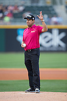 PGA golfer Erik Compton waves to the crowd before throwing out the ceremonial first pitch prior to the International League game between the Louisville Bats and the Charlotte Knights at BB&T BallPark on May 12, 2015 in Charlotte, North Carolina.  Compton has been through two heart transplants and still competes on the PGA Tour.  (Brian Westerholt/Four Seam Images)