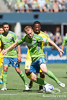 Seattle Sounders FC defender Tyson Wahl (5) takes the ball from the Columbus Crew offense at CenturyLink Field in Seattle, Washington. The Sounders defeated Columbus Crew, 6-2.