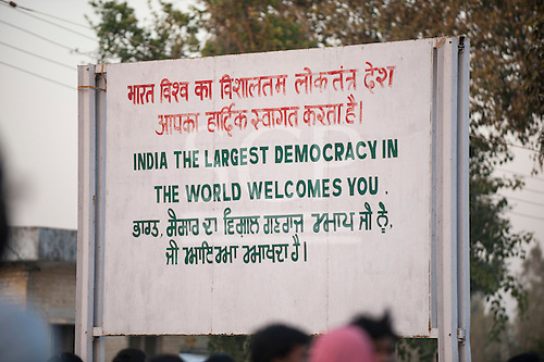 "Amritsar, Punjab, India. Sign: ""India the largest democracy in the World welcomes you"" at the only land border crossing to Pakistan, written in Hindi, English and Punjabi."