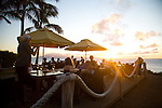 Sunset at Merriman's, where Friday's offer champagne tastings at sunset for $20.  The views of Molokai and Lanai are unsurpassed from this land's end bar, located on the southern point of Kapalua Bay.
