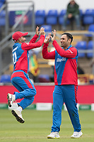 Hashmatullah Shahidi  (Afghanistan)jumps for joy and congratulates Mohammad Nabi (Afghanistan) on the wicket of Lahiru Thrimanne (Sri Lanka) during Afghanistan vs Sri Lanka, ICC World Cup Cricket at Sophia Gardens Cardiff on 4th June 2019