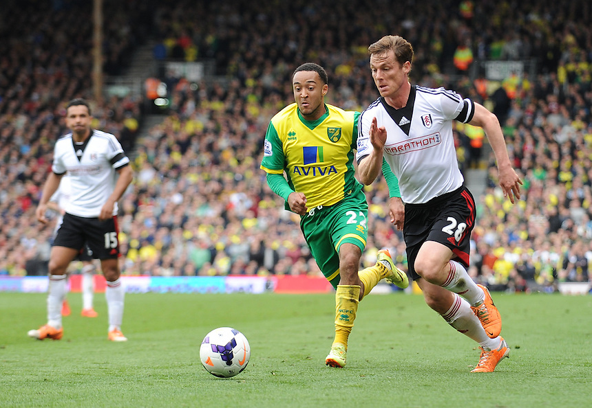 Fulham's Scott Parker holds off the challenge from Norwich City's Nathan Redmond<br /> <br /> Photo by Ashley Western/CameraSport<br /> <br /> Football - Barclays Premiership - Fulham v Norwich City - Saturday 12th April 2014 - Craven Cottage - London<br /> <br /> &copy; CameraSport - 43 Linden Ave. Countesthorpe. Leicester. England. LE8 5PG - Tel: +44 (0) 116 277 4147 - admin@camerasport.com - www.camerasport.com
