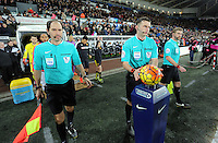 Referee Michael Oliver (C) collects the ball before the Barclays Premier League match between Swansea City and Watford at the Liberty Stadium, Swansea on January 18 2016