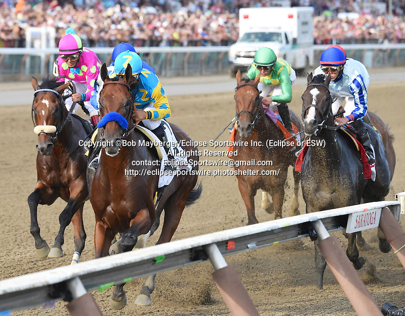 Keen Ice (no. 7), ridden by Javier Castellano and trained by Dale Romans, defeats Triple Crown winner American Pharaoh (no. 2), ridden by Victor Espinoza and trained by Bob Baffert, and wins the 146th running of the grade 1 Travers Stakes for three year olds on August 29, 2015 at Saratoga Race Course in Saratoga Springs, New York. (Bob Mayberger/Eclipse Sportswire)