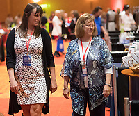 NWA Democrat-Gazette/J.T. WAMPLER Katlyn Taylor of Garfield (left) and Renee' Hutton of Rogers browse the vendors Tuesday Sept 12, 2017 at the Northwest Arkansas Business Women's Conference at the John Q. Hammons Center in Rogers. Taylor and Hutton were at the conference representing the Single Parent Scholarship Fund of Benton County. Sarah Thomas, the first female referee in the  National Football League, was the keynote speaker of the sold-out event.