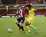 Mark Duffy of Sheffield United battles with Jake Clarke-Salter during the EFL League One match at the Bramall Lane Stadium, Sheffield. Picture date: September 27th, 2016. Pic Jamie Tyerman/Sportimage