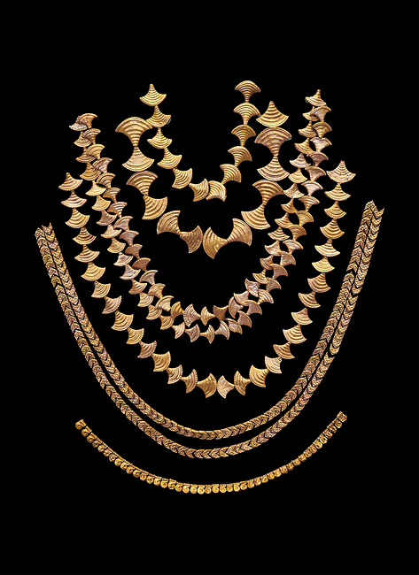 Mycenaean gold necklaces from the Mycenae chamber tombs, Greece. National Archaeological Museum Athens. Black Background<br /> <br /> From top to bottom: <br /> <br /> Top four  necklaces in the shape of papyrus flowers .<br /> <br /> Fifth necklace down in the shape of Ivy leaves from tomb 91 Cat No 3186<br /> <br /> <br /> Bottom necklace with beads in the shape of hangimng scrolls from tomb 25 Cat No 2478.